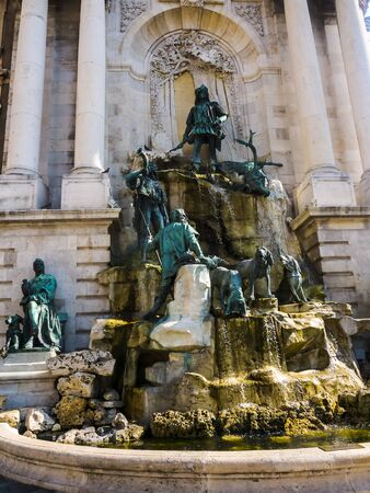 The Hunters Fountain at the Royal Palace of the Austro-Hungarian, Hapsburg Kings stands high above the city of Budapest in Hungary watching over the city below. The views of the river and city from its terraces are wonderful and the castle is very imposin