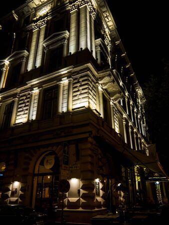 Hotel on the famous Andrassy Street in Budapest lit up at night