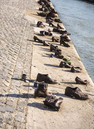 The monument of the shoes on the banks of the River Danube near the Houses of Parliament in Budapest This memorial is simple yet chilling, depicting the shoes left behind by the thousands of Jews who were murdered by the Arrow Cross a Nazi death squad