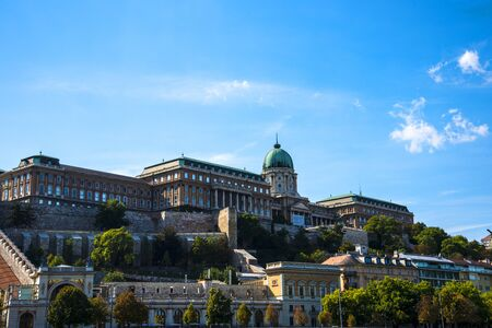 The Royal Palace of the Austro-Hungarian, Hapsburg Kings stands high above the city of Budapest in Hungary watching over the city below. The views of the river and city from its terraces are wonderful and the castle is very imposing Editorial