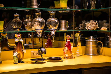 Collection of Glass at Graceland which is a mansion in Memphis, Tennessee and was home to Elvis Presley. It opened to the public in 1982. Graceland has become one of the most-visited private homes in America with over 650,000 visitors a year
