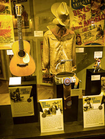 The Country Music Hall of Fame in Nashville Tennessee USA shaped like a flying Piano Keyboard and hosts many mobile exhibitions relating to country music and musicians