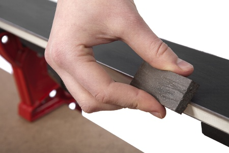 removing burrs from ski edges with rubber abrasive block