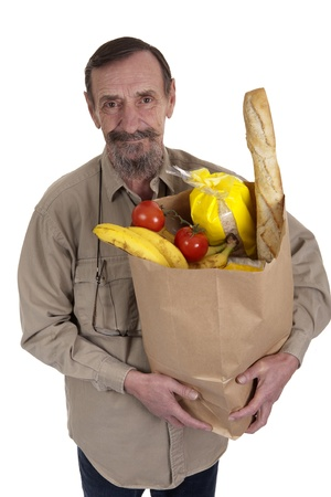 elderly man carrying groceries in a paper bag