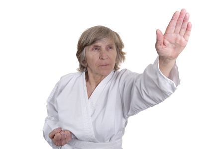 active grandmother in karate pose