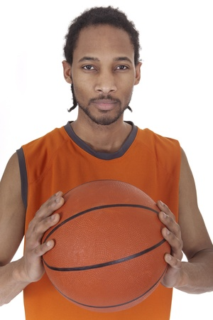 male basketball player holding a ball between two hands Stock Photo