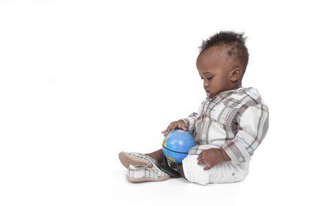 toddler studying the Globe Stock fotó