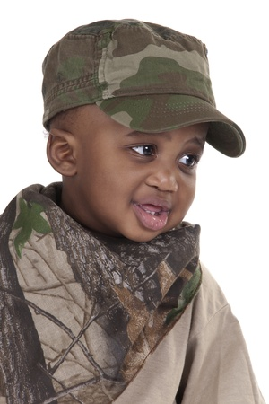 toddler wearing army clothes on white background Stock Photo
