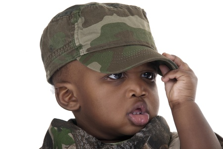 child wearing a camouflage uniform and cap on white background Stock Photo