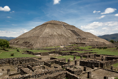 the world's third largest pyramid, the pyramid of the Sun in Teotihuacan with ruin walls in the foreground on a rare smog free day