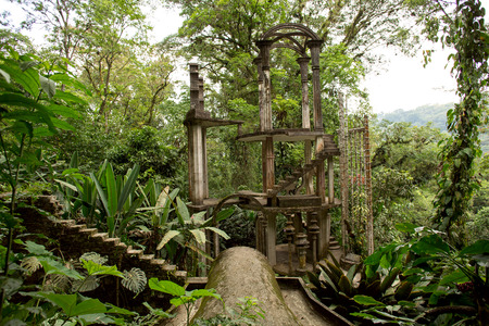 tropical: surreal concrete structure with stairs in tropical jungle setting