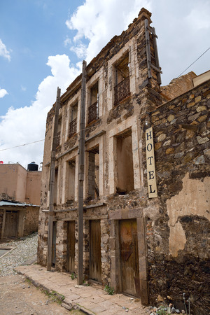 abandoned crumling hotel facade in the ghost town of Real de Catorce