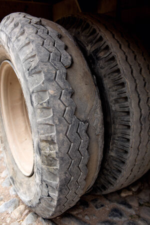 treads: truck tires worn to the extreme with missing treads Stock Photo