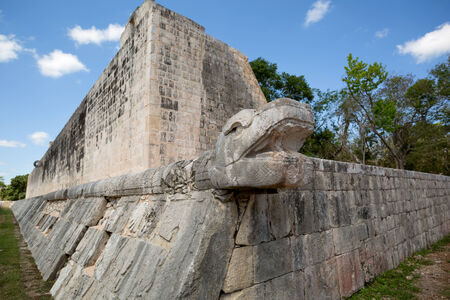 snake head: Mayan snake head sculture on anient ball court