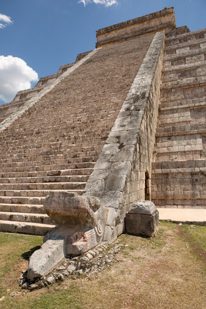snake head: Mayan temple stairs with sculpted snake head in the foreground