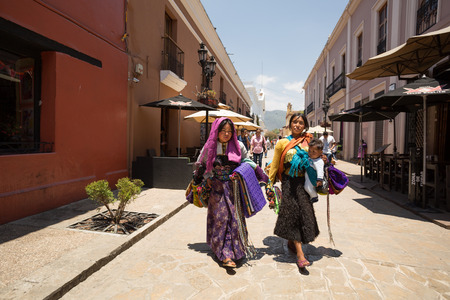 April 14,2014 - Tzotzil women walking in San Cristobal de las Casas, Chiapas dressed in traditional clothing. They sell crafts and traditional merchandise to tourists.