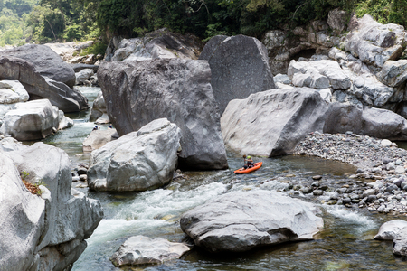 kayaker: April 17,2015, Cangrejal River, Honduras: a kayaker is negotiating the rapids at one of Honduras most popular whitewater rafting location