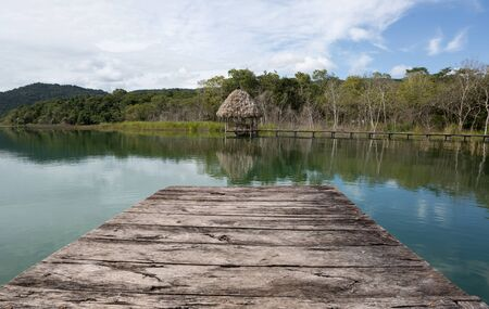 palapa: lake Peten Itza seen from wooden dock in Northern Guatemala