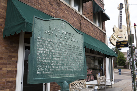 plaque: June 2, 2015 Memphis, Tennessee: the Elvis Presley comemorative plaque in the front of Sun Records with the studio building in the background