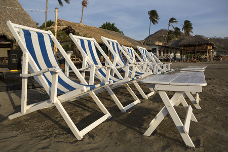 lining up: striped beach chairs lining up on the Pacific beach of San Juan del Sur Nicaragua Stock Photo