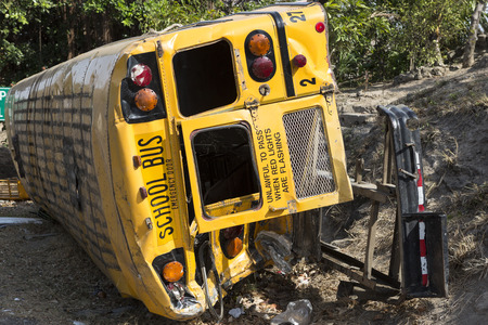 danger of accident: school bus rolled over in accident Stock Photo