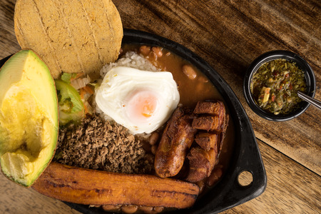 typical colombian food from the Medellin area called Paisa Bandeja Фото со стока