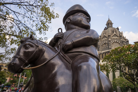 October 19,2016 Medellin,Colombia: surrealist statue of a man on horseback donated by Botero to his birth city displayed publicly in the park named after the author