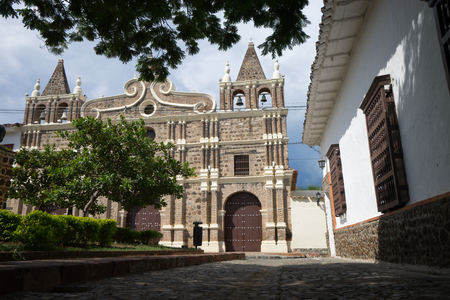 colonial church with small park in front in Santa Fe de Antioquia Colombia
