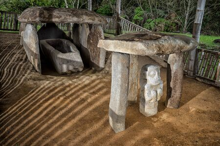 ancient pre-columbian tomb  in San Agustin Colombia with statue in ALtos de los Idolos, San Agustin, Colombia