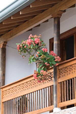 building exteriors: colonial balcony with flower