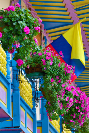 building exteriors: colonial balcony decorated with flowers in Filandia Colombia Stock Photo