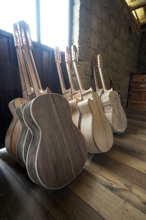 unfinished guitars at luthiers shop in Ecuador