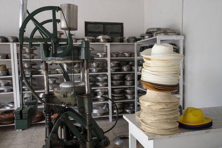 Panama hats with vintage press in Cuenca Ecuador Stock Photo