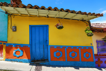 building exteriors: historical colourful house with decoration called zocalos in Guatape Colombia