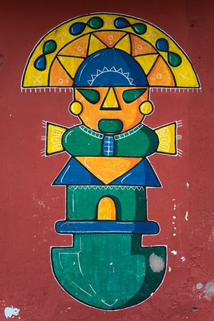 indigenous themed wall painting in Ecuador