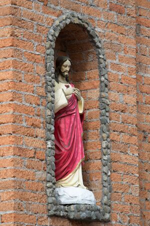 religious statue in wall niche in Colombia