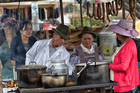 July 15, 2017 Villa de Leyva, Colombia: people at a food stand at the weekly Saturday market in the colonial town Redakční