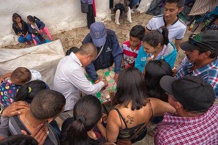 July 16, 2017 Villa de Leyva, Colombia: people gather around a money game during the towns yearly fiesta