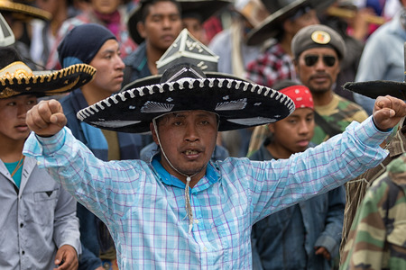 June 29, 2017 Cotacachi, Ecuador: kichwa indigenous people with extra large hats dancing on the street during Inti Raymi festival Editorial