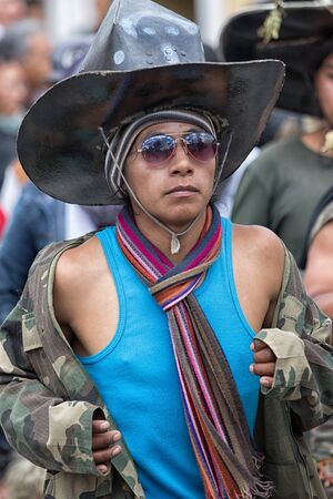 June 29, 2017 Cotacachi, Ecuador: kichwa indigenous man with extra large hat  dancing on the street during Inti Raymi festival