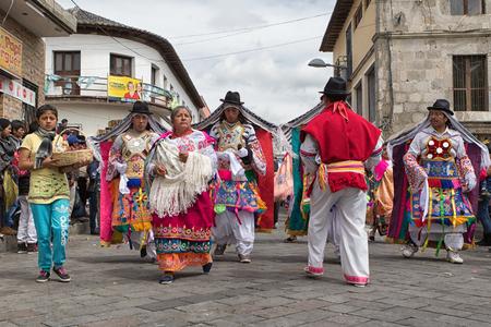 June 18, 2017 Pujili, Ecuador: indigenous kichwa peple dancing in the street in traditional dress at Corpus Christi parade