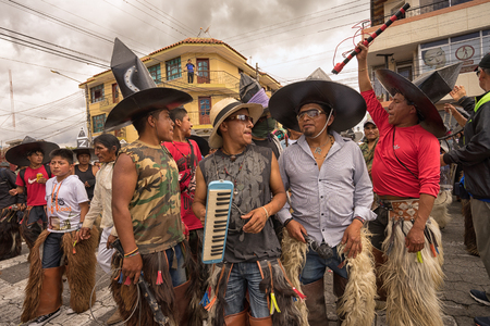June 24, 2017 Cotacachi, Ecuador: a group of indigenous kichwa men  participating at an Inti Raymi parade at summer solstice