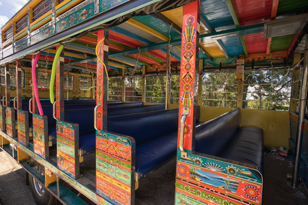 August 6, 2017 Medellin, Colombia: colourful vintage buses called chiva used for cheap public transportation are popular all through the country