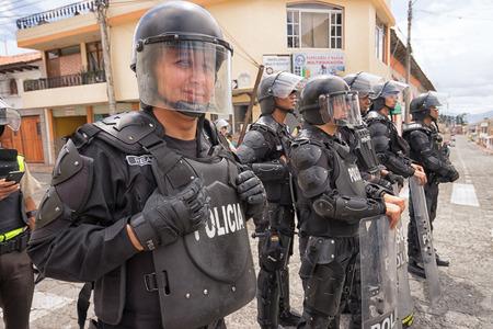 June 24, 2017 Cotacachi, Ecuador: riot police closing off access to a street at the Inti Raymi parade at summer solstice