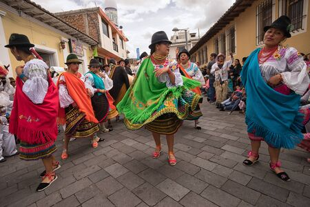 June 17, 2017 Pujili, Ecuador: women dancers in brightly colored clothing at the Corpus Christi parade Editorial