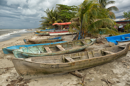 March 8, 2015 Sambo Creek, Honduras: dugout canoes on the beach by the samll garifuna fishing village Editorial