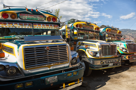 January 18, 2015 San Pedro la Laguna, Guatemala: old school buses painted in vivid colours and fitted for public transportation are called commonly chicken bus by travelers