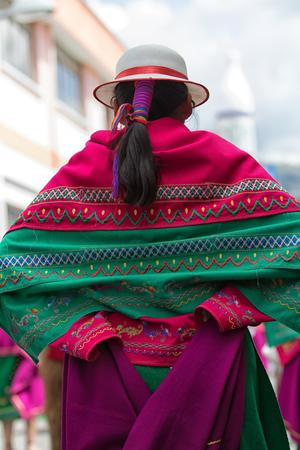 June 17, 2017 Pujili, Ecuador: closeup detaisl of a kichwa indigenous young woman dancing in a colorful traditional dress at Corpus Christi parade Stock Photo