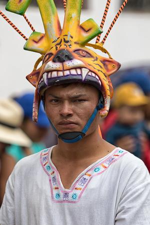 June 17, 2017 Pujili, Ecuador: indigenous quichua man wearing a mask during the Corpus Christi annual parade Editorial