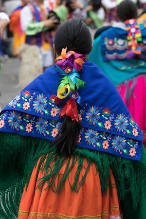 June 17, 2017 Pujili, Ecuador: closeup detaisl of a kichwa indigenous woman dancing in a colorful traditional dress at Corpus Christi parade Stock Photo